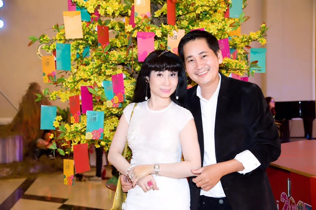 Uyên Thảo tình tứ với đạo diễn Lê Minh tại sự kiện