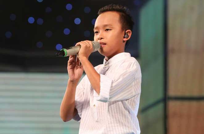 Cậu bé hát đám cưới tiếp tục gây sốt ở Vietnam Idol Kids