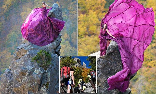 Cô gái mạo hiểm tạo dáng trên mỏm đá cao 914 m