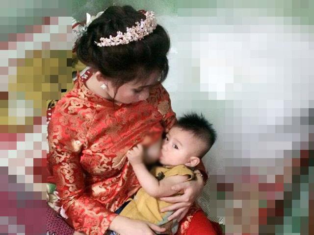 Cô dâu kéo váy cưới cho con bú gây xôn xao trên mạng