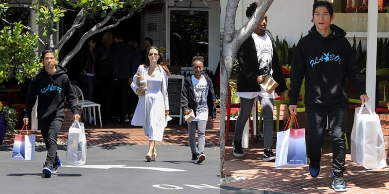 Pax Thiên ga lăng xách đồ giúp mẹ Angelina Jolie và em gái