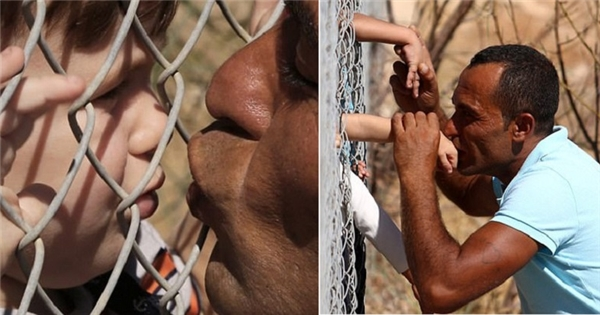 Lặng người trước bức ảnh Cha hôn con qua song sắt sau 1 năm chia cách