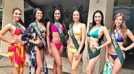 Hà Thu đọ dáng cùng thí sinh Hoa hậu Trái đất trong trang phục bikini