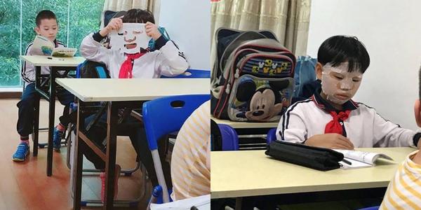 """Cậu bé """"hồn nhiên như cô tiên"""" đắp mặt nạ ngay trong lớp học một cách rất chuyên nghiệp"""