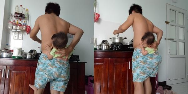 """Ông bố """"vừa địu con trong quần"""" vừa đứng nấu cơm gây sốt"""