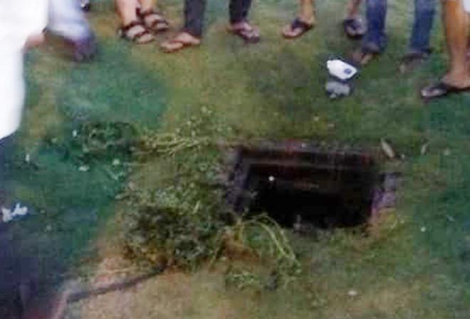 Bé gái nguy kịch vì rơi xuống cống thoát nước