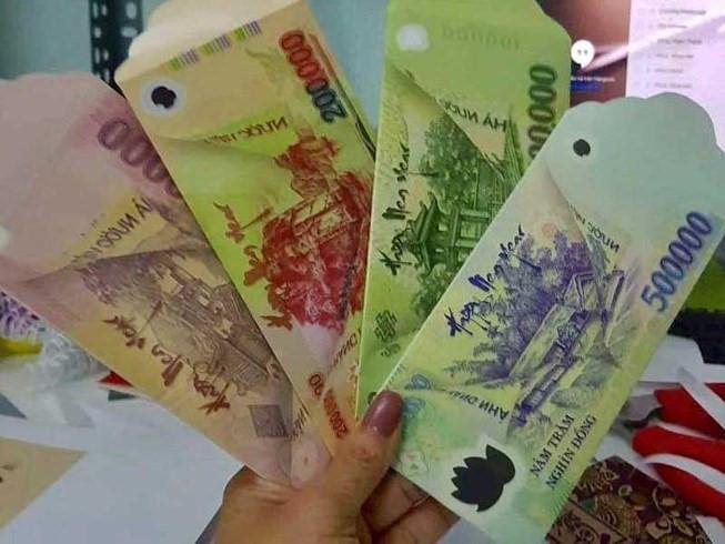 Cấm sử dụng trái phép hình ảnh tiền Việt Nam làm bao lì xì