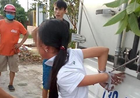 Mất tiền, gia đình trói cháu gái 12 tuổi vào thùng xe tải đánh đập
